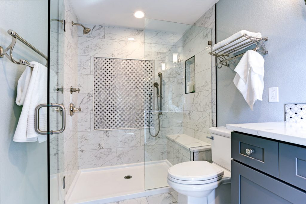 amazing bathroom with walk in shower and gray vanity - bathroom remodeling by top home builders