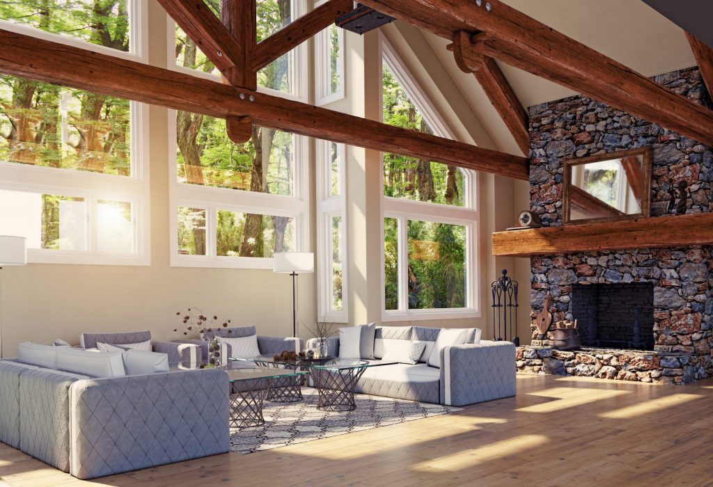 custom home expansion living room with build in fireplace and wooden support beam