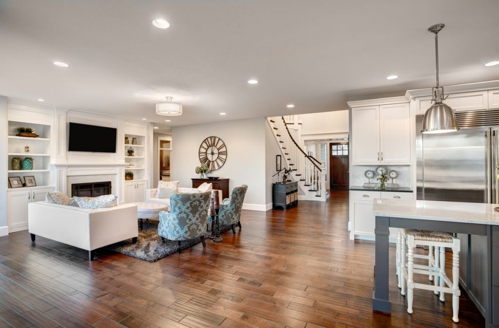 amazing family room with build in fireplace and ceiling potlights - home remodeling by top home builders