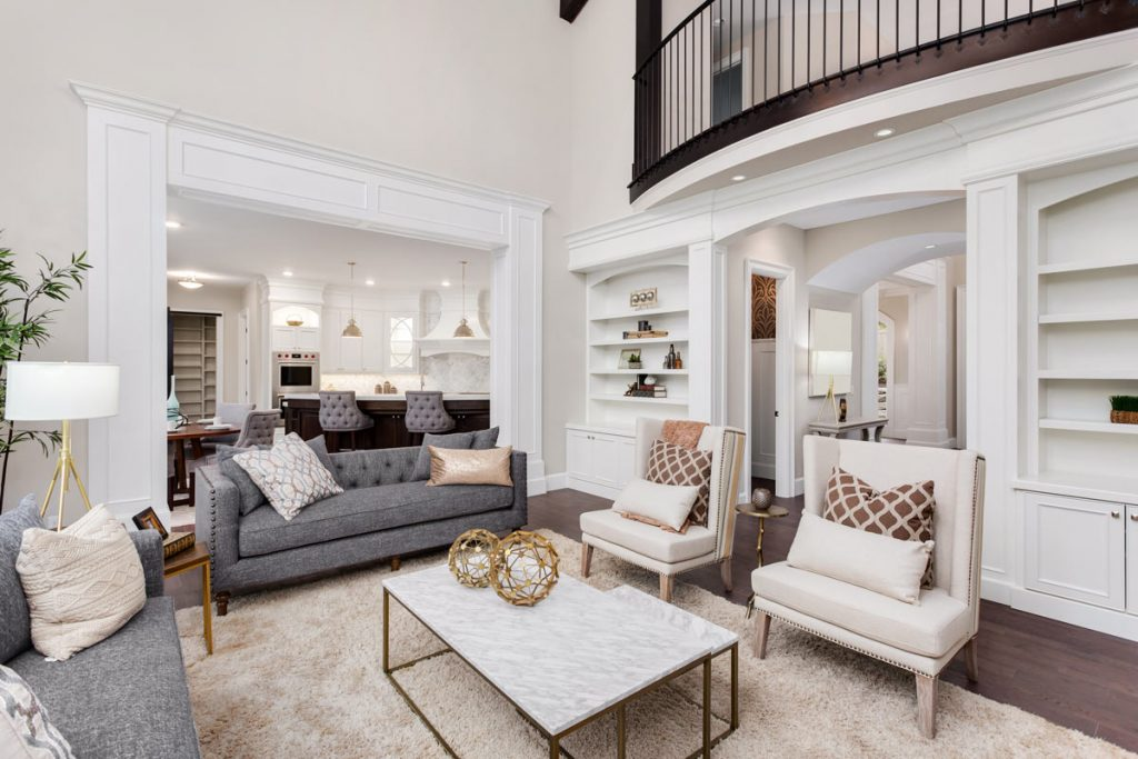 custom living room with baseboard trim and floor carpet - house remodeling services