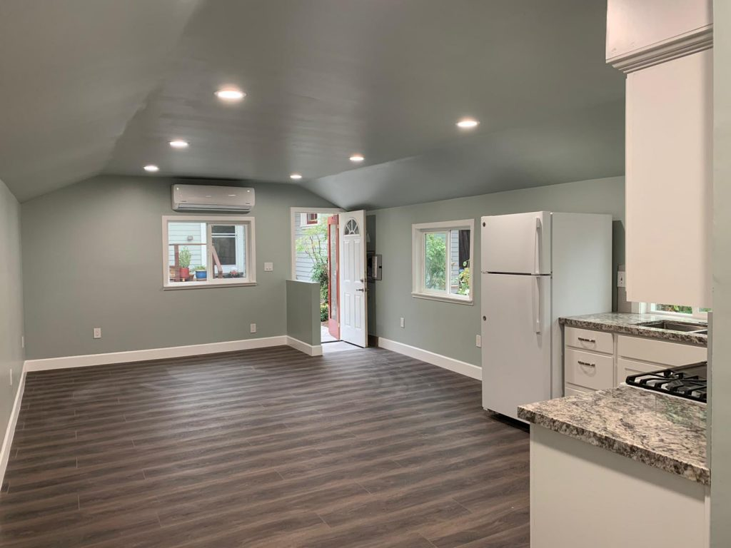 second floor family room with small kitchen - house remodeling by top home builders