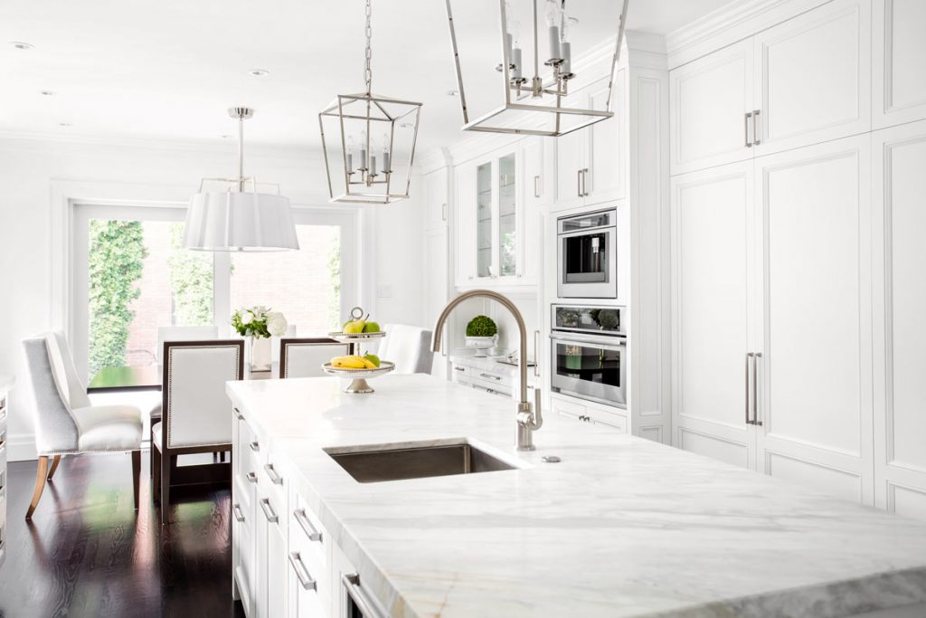 modern kitchen with marble counter top - kitchen remodeling by top home builders