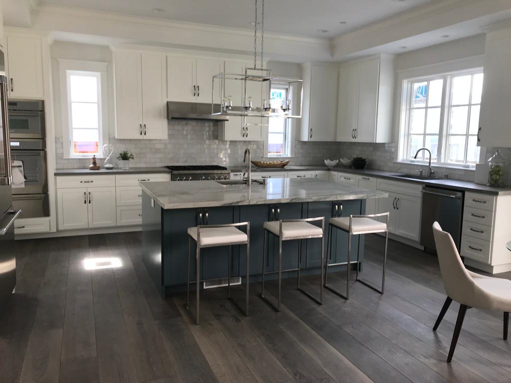 modern amazing kitchen with white cabinets and glass splash wall - kitchen remodeling by top home builders