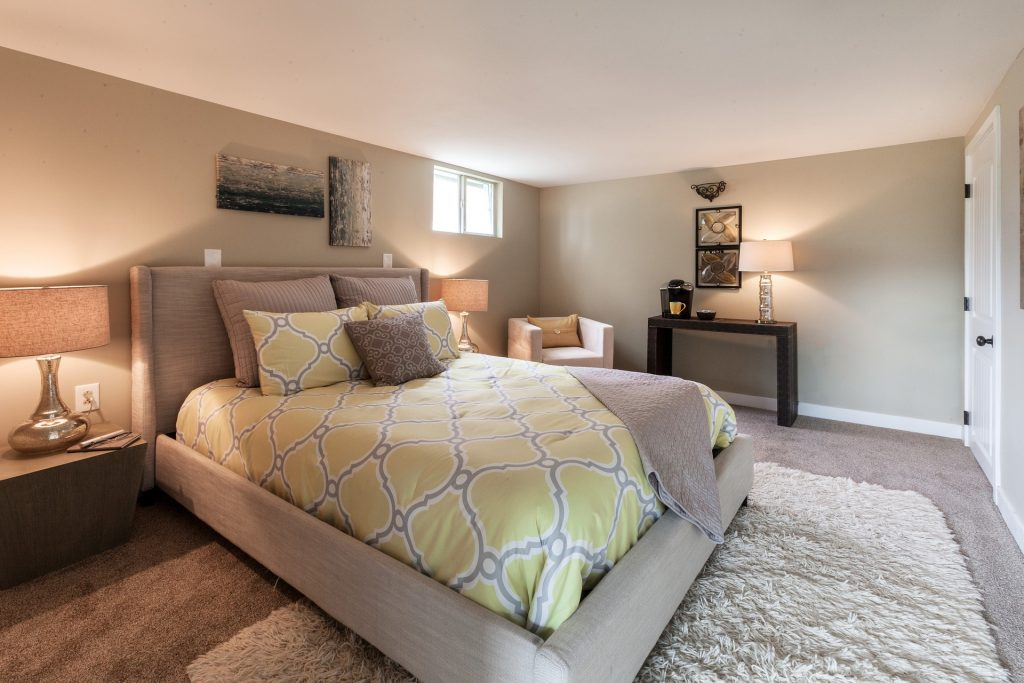 custom bedroom with amazing floor carpet and baseboard trim - ADU Construction by top home builders