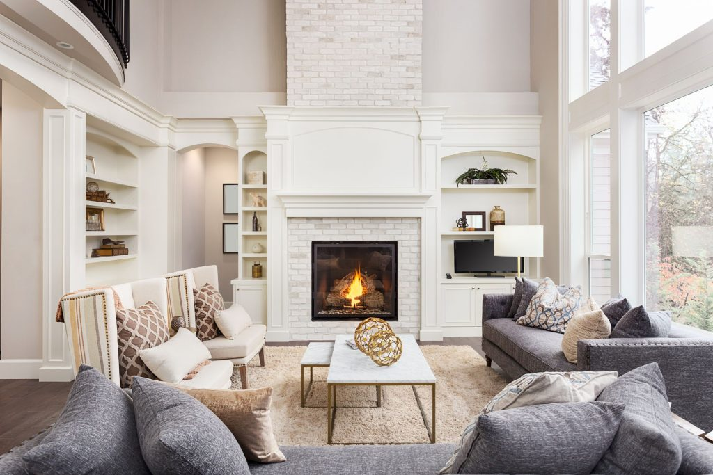 classic family room with crown moudling trim and build in fireplace