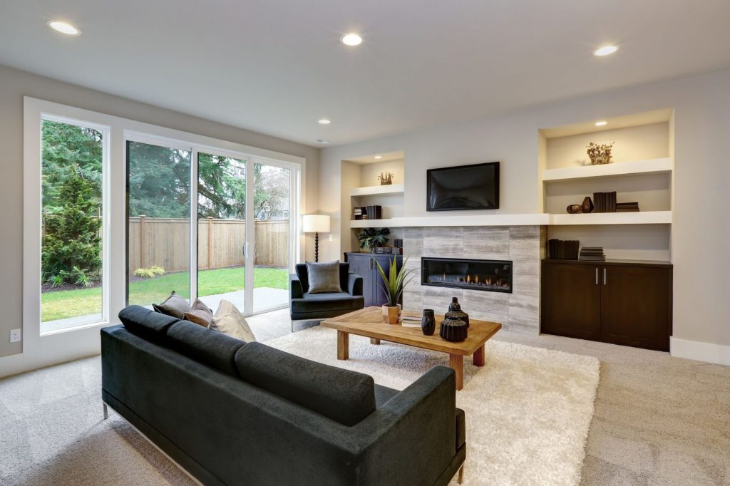 family room remodeling with build in fireplace and floor carpet