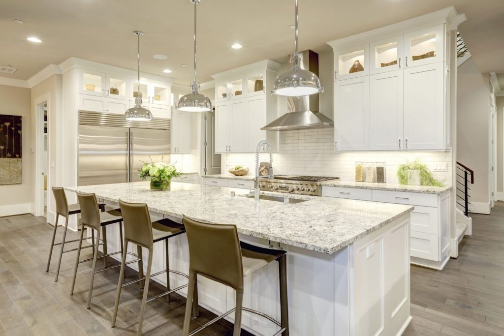 amazing kitchen with backlit cabinets and crown moulding trim - kitchen remolding contractors