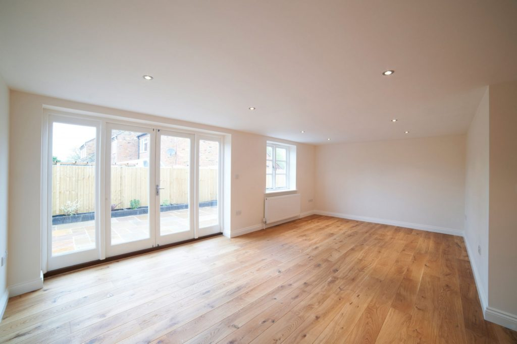 custom home expansions with wooden floor and baseboard trim