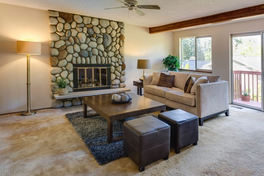 luxury family room with build in fireplace and carpet floor - home remodeling by top home builders