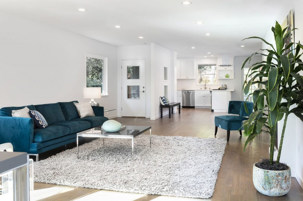 Amazing Family Room with Blue Sofa and Wooden Floor - Custom Homes Renovations San Jose
