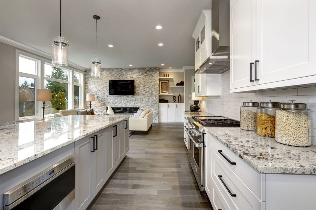 Luxury Kitchen with Crown Moudling Trim and White Kitchen Cabinets - Kitchen Remodeling San Jose